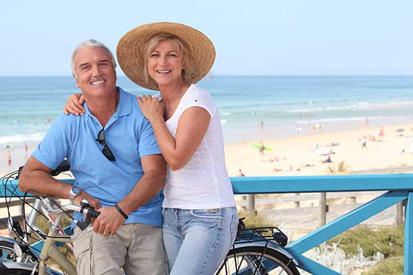 mature dating couple on a bike